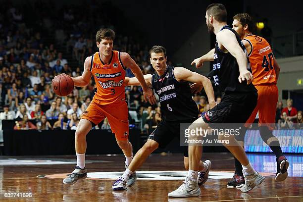Cameron Gliddon of the Taipans dribbles past Kirk Penney of the Breakers during the round 17 NBL match between the New Zealand Breakers and the...