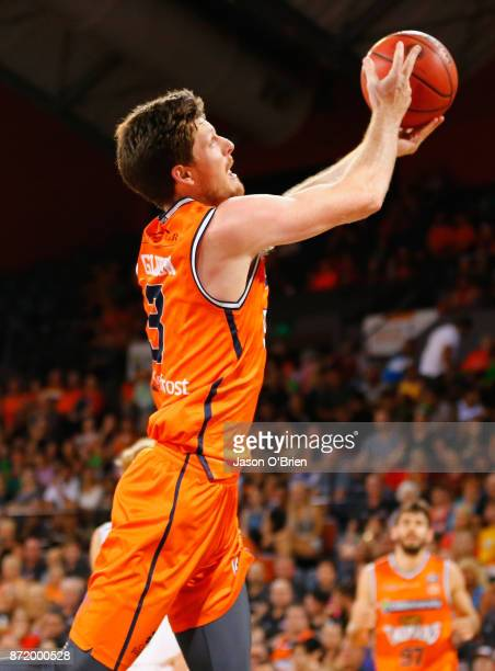 Cameron Gliddon of the Taipans flicks the ball back over his head to score a basket during the round six NBL match between the Cairns Taipans and...
