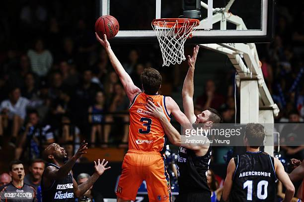 Cameron Gliddon of the Taipans goes to the basket against Alex Pledger of the Breakers during the round 17 NBL match between the New Zealand Breakers...