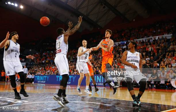 Cameron Gliddon of the Taipans passes during the round six NBL match between the Cairns Taipans and Melbourne United at Cairns Convention Centre on...