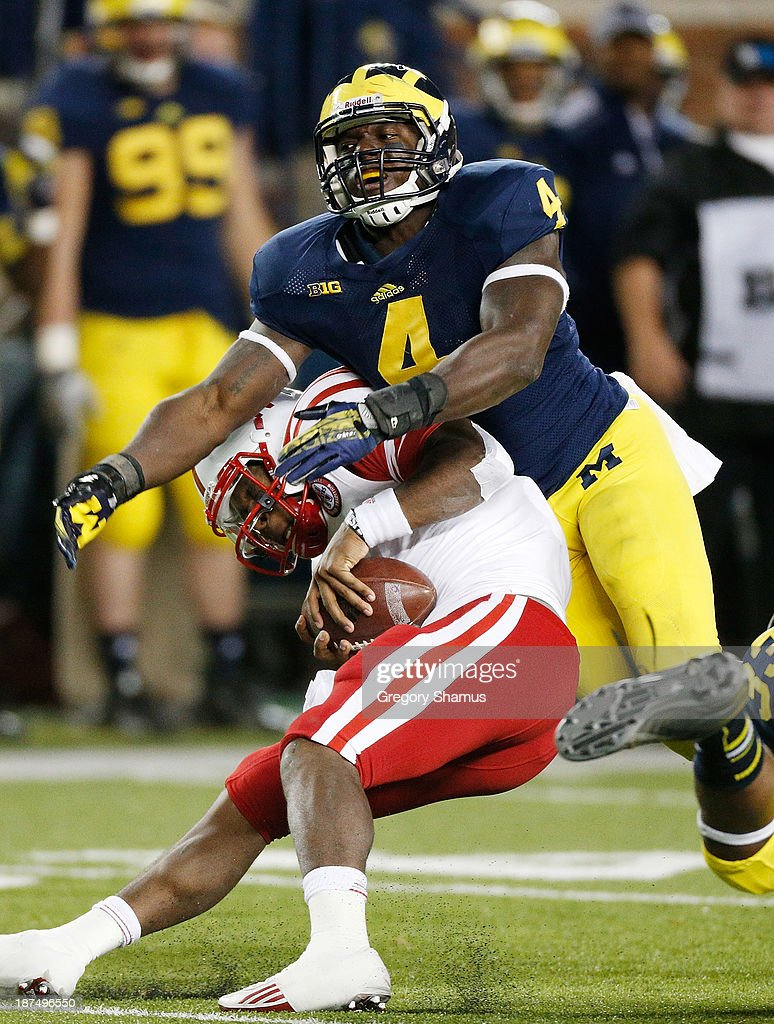 Cameron Gordon #4 of the Michigan Wolverines sacks Tommy Armstrong Jr. #4 of the Nebraska Cornhuskers in the second half at Michigan Stadium on November 9, 2013 in Ann Arbor, Michigan.