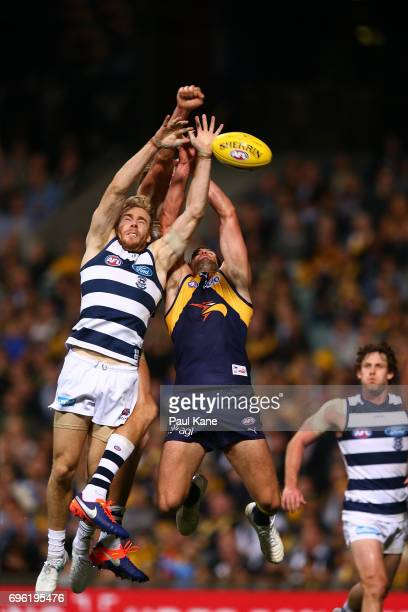 Cameron Guthrie of the Cats contests for a mark against Jack Darling of the Eagles during the round 13 AFL match between the West Coast Eagles and...