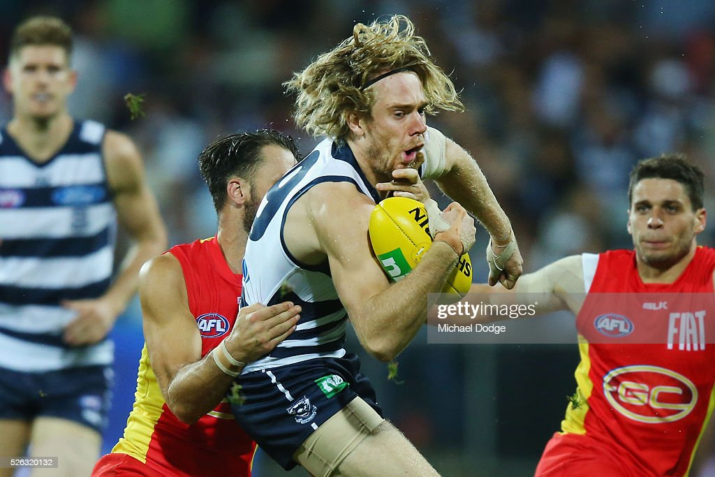 Cameron Guthrie of the Cats is tackled by Nick Malceski of the Suns during the round six AFL match between the Geelong Cats and the Gold Coast Suns at Simonds Stadium on April 30, 2016 in Geelong, Australia.