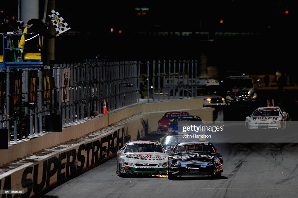 Cameron Hayley, driver of the #24 Cabinets By Hayley/GPM Ford, crosses the finish line ahead of Gray Gaulding, driver of the #20 Krispy Kreme Toyota, to win the K&N Pro Series UNOH Battle At The Beach at Daytona International Speedway on February 19, 2013 in Daytona Beach, Florida.