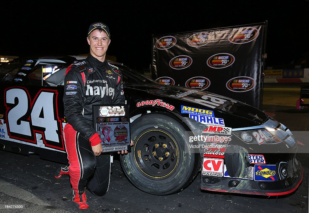 Cameron Hayley, driver of the #24 Cabinets by Hayley/GPM Ford, poses with the trophy after winning the NASCAR K&N Toyota/NAPA Auto Parts 150 at All American Speedway on October 12, 2013 in Roseville, California.