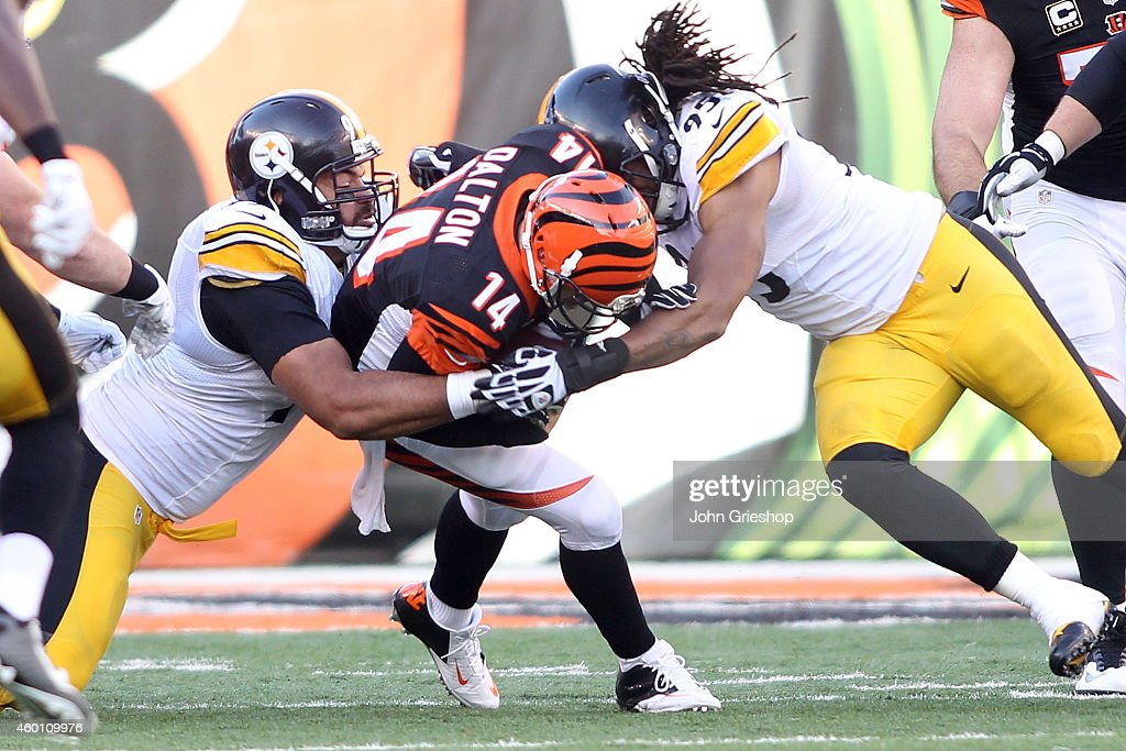 <a gi-track='captionPersonalityLinkClicked' href=/galleries/search?phrase=Cameron+Heyward&family=editorial&specificpeople=4524172 ng-click='$event.stopPropagation()'>Cameron Heyward</a> #97 of the Pittsburgh Steelers and <a gi-track='captionPersonalityLinkClicked' href=/galleries/search?phrase=Jarvis+Jones&family=editorial&specificpeople=6236463 ng-click='$event.stopPropagation()'>Jarvis Jones</a> #95 of the Pittsburgh Steelers combine to tackle <a gi-track='captionPersonalityLinkClicked' href=/galleries/search?phrase=Andy+Dalton+-+American+Football+Player&family=editorial&specificpeople=15271549 ng-click='$event.stopPropagation()'>Andy Dalton</a> #14 of the Cincinnati Bengals during the third quarter at Paul Brown Stadium on December 7, 2014 in Cincinnati, Ohio.