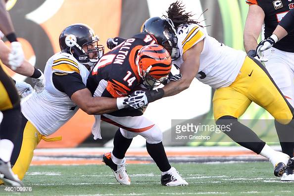 Cameron Heyward of the Pittsburgh Steelers and Jarvis Jones of the Pittsburgh Steelers combine to tackle Andy Dalton of the Cincinnati Bengals during...