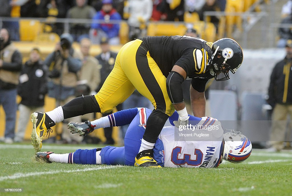 <a gi-track='captionPersonalityLinkClicked' href=/galleries/search?phrase=Cameron+Heyward&family=editorial&specificpeople=4524172 ng-click='$event.stopPropagation()'>Cameron Heyward</a> #97 of the Pittsburgh Steelers sacks <a gi-track='captionPersonalityLinkClicked' href=/galleries/search?phrase=E.J.+Manuel&family=editorial&specificpeople=5590292 ng-click='$event.stopPropagation()'>E.J. Manuel</a> #3 during the fourth quarter at Heinz Field on November 10, 2013 in Pittsburgh, Pennsylvania.