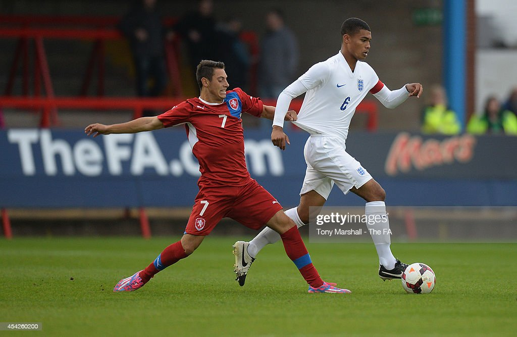 Cameron Humphreys of England is tackled byJiri Miker of Czech Republic during the Under 17 International match between England U17 and Czech Republic U17 at Aggborough Stadium on August 27, 2014 in Kidderminster, England.