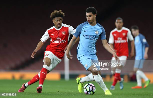 Cameron Humphreys of Manchester City is closed down by Reiss Nelson of Arsenal during the Premier League 2 match between Arsenal and Manchester City...