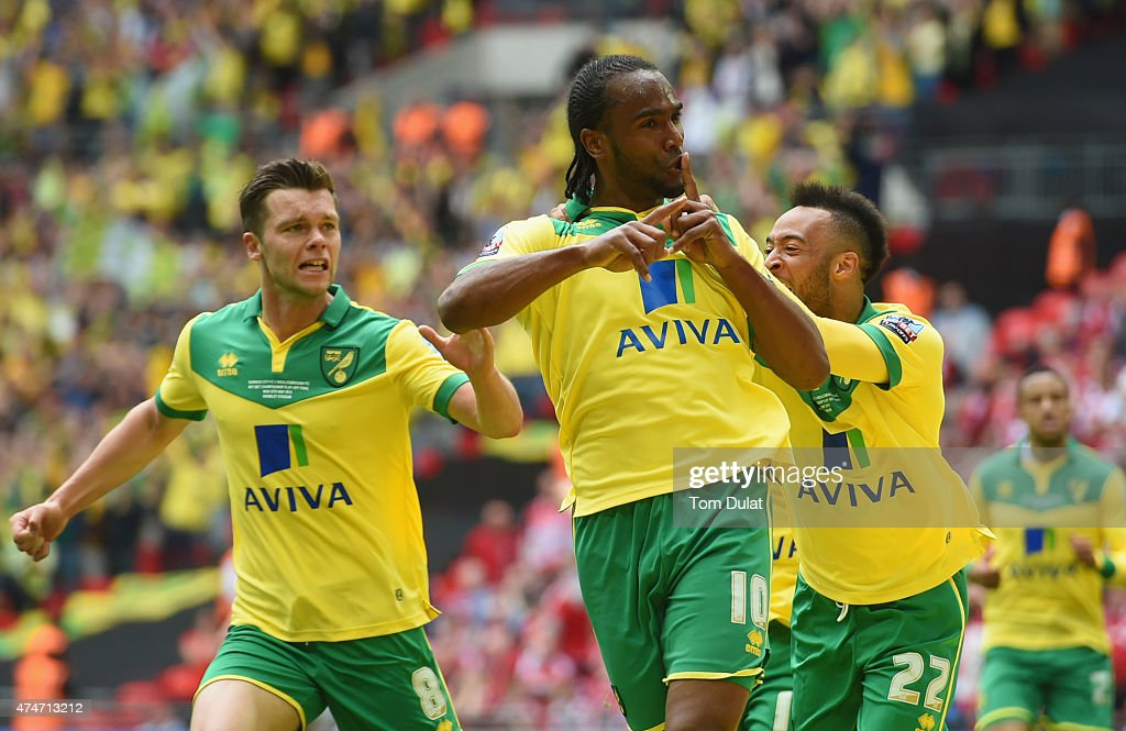 <a gi-track='captionPersonalityLinkClicked' href=/galleries/search?phrase=Cameron+Jerome&family=editorial&specificpeople=815275 ng-click='$event.stopPropagation()'>Cameron Jerome</a> of Norwich City (10) celebrates as he scores their first goal with Jonathan Howson (8) and <a gi-track='captionPersonalityLinkClicked' href=/galleries/search?phrase=Nathan+Redmond&family=editorial&specificpeople=6489095 ng-click='$event.stopPropagation()'>Nathan Redmond</a> (27) during the Sky Bet Championship Playoff Final between Middlesbrough and Norwich City at Wembley Stadium on May 25, 2015 in London, England.