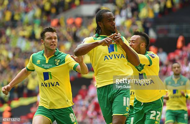 Cameron Jerome of Norwich City celebrates as he scores their first goal with Jonathan Howson and Nathan Redmond during the Sky Bet Championship...