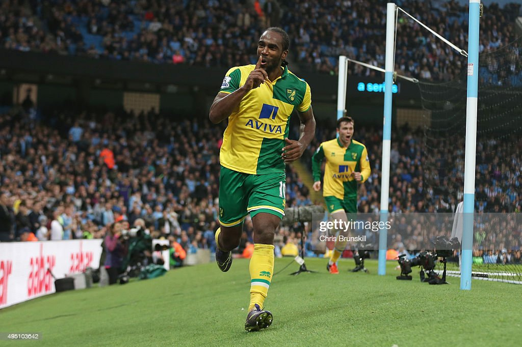 <a gi-track='captionPersonalityLinkClicked' href=/galleries/search?phrase=Cameron+Jerome&family=editorial&specificpeople=815275 ng-click='$event.stopPropagation()'>Cameron Jerome</a> of Norwich City celebrates scoring his team's first goal during the Barclays Premier League match between Manchester City and Norwich City at Etihad Stadium on October 31, 2015 in Manchester, England.