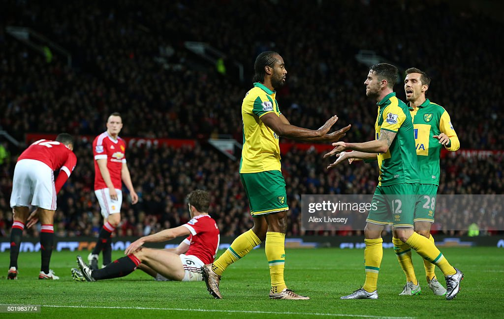 <a gi-track='captionPersonalityLinkClicked' href=/galleries/search?phrase=Cameron+Jerome&family=editorial&specificpeople=815275 ng-click='$event.stopPropagation()'>Cameron Jerome</a> (3rd R) of Norwich City celebrates scoring his team's first goal with his team mates <a gi-track='captionPersonalityLinkClicked' href=/galleries/search?phrase=Robbie+Brady&family=editorial&specificpeople=9028769 ng-click='$event.stopPropagation()'>Robbie Brady</a> (2nd R) and <a gi-track='captionPersonalityLinkClicked' href=/galleries/search?phrase=Gary+O%27Neil&family=editorial&specificpeople=683120 ng-click='$event.stopPropagation()'>Gary O'Neil</a> (1st R) during the Barclays Premier League match between Manchester United and Norwich City at Old Trafford on December 19, 2015 in Manchester, England.