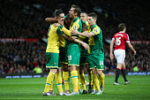Cameron Jerome of Norwich City celebrates scoring his team's first goal with his team mates during the Barclays Premier League match between...