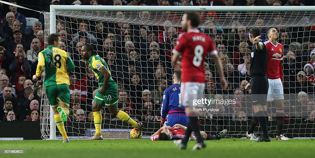 <a gi-track='captionPersonalityLinkClicked' href=/galleries/search?phrase=Cameron+Jerome&family=editorial&specificpeople=815275 ng-click='$event.stopPropagation()'>Cameron Jerome</a> (2nd L) of Norwich City celebrates scoring their first goal during the Barclays Premier League match between Manchester United and Norwich City at Old Trafford on December 19, 2015 in Manchester, England.