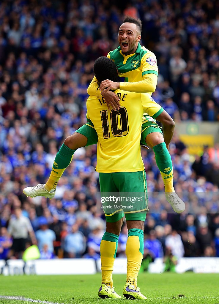 Cameron Jerome of Norwich City celebrates with team mate Nathan Redmond as he scores their third goal during the Sky Bet Championship Playoff semi...