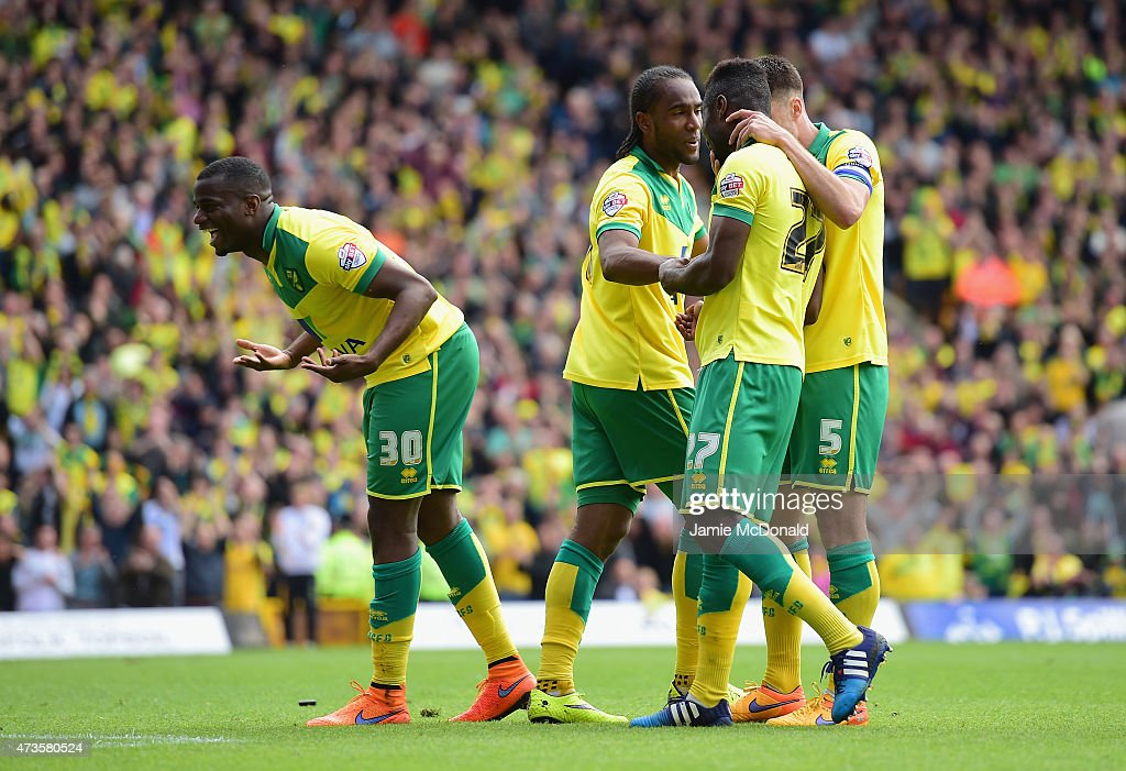 Cameron Jerome of Norwich City celebrates with team mates as he scores their third goal during the Sky Bet Championship Playoff semi final second leg...