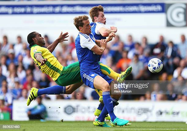 Cameron Jerome of Norwich City challenges for the ball with Christophe Berra and Adam Webster of Ipswich Town during the Sky Bet Championship match...