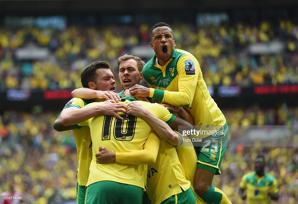 <a gi-track='captionPersonalityLinkClicked' href=/galleries/search?phrase=Cameron+Jerome&family=editorial&specificpeople=815275 ng-click='$event.stopPropagation()'>Cameron Jerome</a> of Norwich City (10) is congratulated by <a gi-track='captionPersonalityLinkClicked' href=/galleries/search?phrase=Martin+Olsson&family=editorial&specificpeople=4185617 ng-click='$event.stopPropagation()'>Martin Olsson</a> (23) and team mates as he scores their first goal during the Sky Bet Championship Playoff Final between Middlesbrough and Norwich City at Wembley Stadium on May 25, 2015 in London, England.