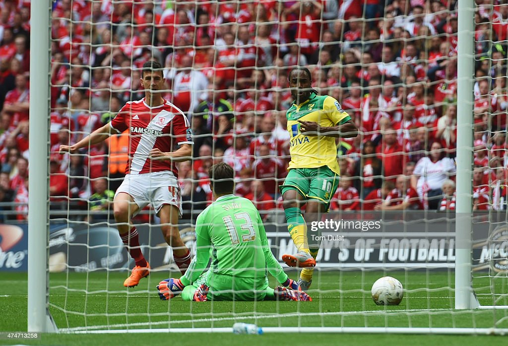 <a gi-track='captionPersonalityLinkClicked' href=/galleries/search?phrase=Cameron+Jerome&family=editorial&specificpeople=815275 ng-click='$event.stopPropagation()'>Cameron Jerome</a> of Norwich City (10) scores their first goal past gaolakeeper Dimitrios Konstantopoulos of Middlesbrough during the Sky Bet Championship Playoff Final between Middlesbrough and Norwich City at Wembley Stadium on May 25, 2015 in London, England.