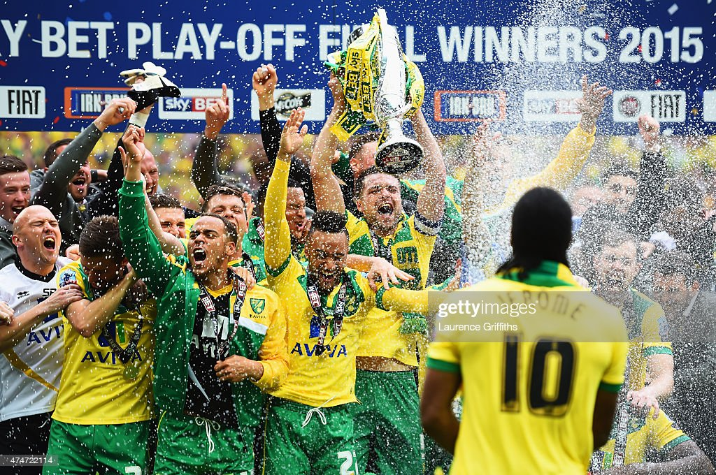 Cameron Jerome of Norwich City (10) sprays his team mates with champagne in celebration after the Sky Bet Championship Playoff Final between Middlesbrough and Norwich City at Wembley Stadium on May 25, 2015 in London, England. Norwich City seal promotion to the Premier League with a 2-0 victory