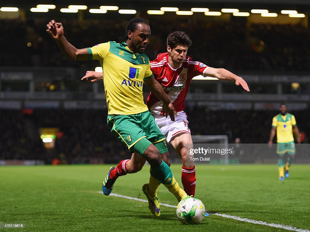 Cameron Jerome of Norwich City takes on George Friend of Middlesbrough during the Sky Bet Championship match between Norwich City and Middlesbrough...