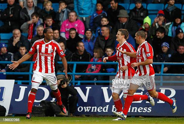 Cameron Jerome of Stoke City celebrates his goal with teammates Robert Huth and Jonathan Walters during the FA Cup Third Round match between...