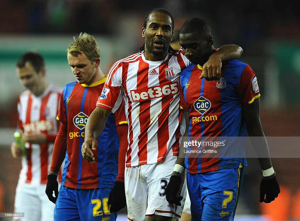 <a gi-track='captionPersonalityLinkClicked' href=/galleries/search?phrase=Cameron+Jerome&family=editorial&specificpeople=815275 ng-click='$event.stopPropagation()'>Cameron Jerome</a> of Stoke City consoles Yannick Bolasie of Crystal Palace during the FA Cup with Budweiser Third Round replay match between Stoke City and Crystal Palace at Britannia Stadium on January 15, 2013 in Stoke on Trent, England.
