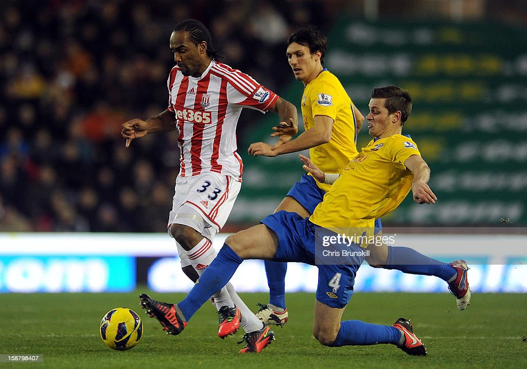 Cameron Jerome of Stoke City in action with Morgan Schneiderlin of Southampton during the Barclays Premier League match between Stoke City and Southampton at Britannia Stadium on December 29, 2012 in Stoke on Trent, England.