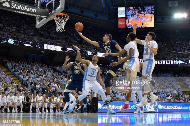 Cameron Johnson of the Pittsburgh Panthers drives past Brandon Robinson of the North Carolina Tar Heels during the game at the Dean Smith Center on...