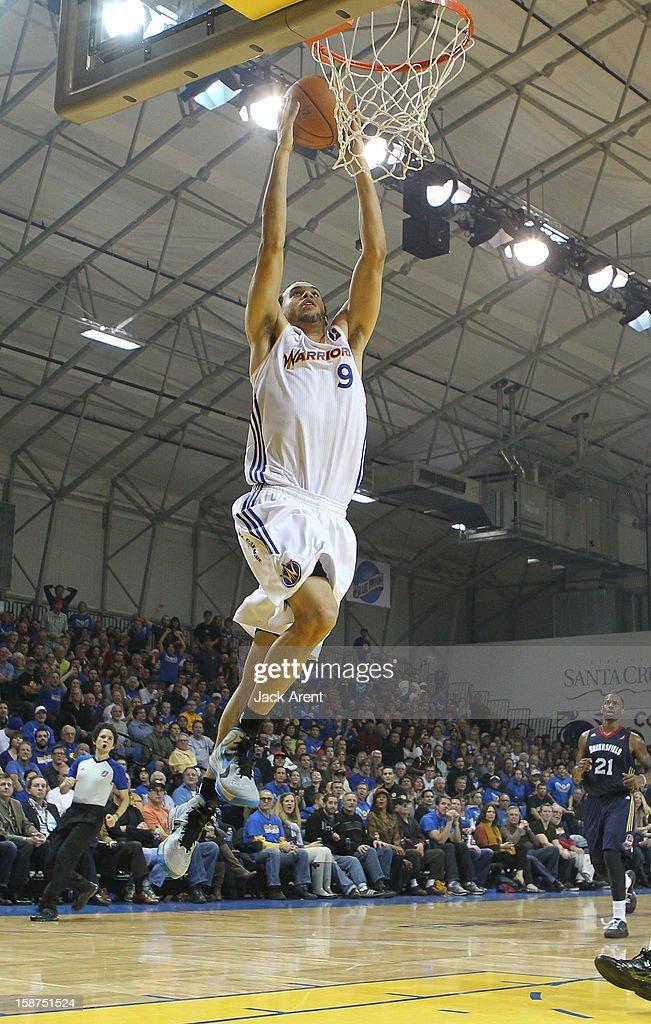 Cameron Jones #9 of the Santa Cruz Warriors slam dunks the ball against the Bakersfield Jam on December 23, 2012 at Kaiser Permanente Arena in Santa Cruz, California.