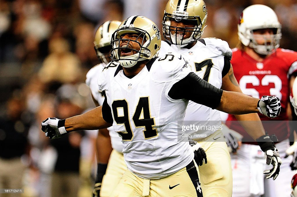 Cameron Jordan #94 of the New Orleans Saints celebrates a sack against the Arizona Cardinals during a game at the Mercedes-Benz Superdome on September 22, 2013 in New Orleans, Louisiana. The Saints defeated the Cardinals 31-7.