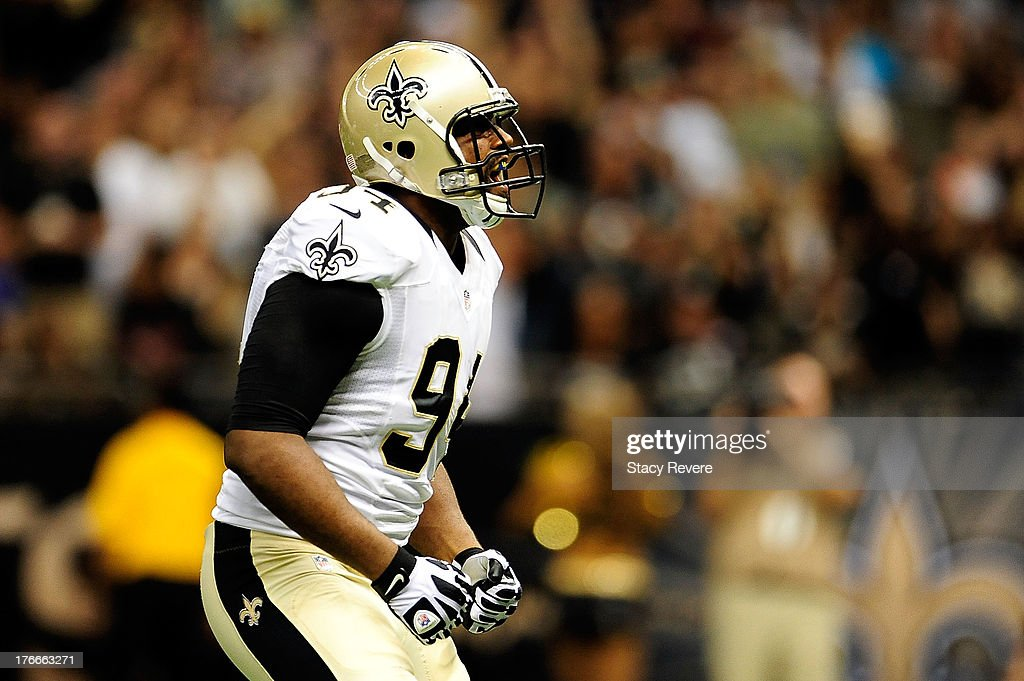 <a gi-track='captionPersonalityLinkClicked' href=/galleries/search?phrase=Cameron+Jordan&family=editorial&specificpeople=5574235 ng-click='$event.stopPropagation()'>Cameron Jordan</a> #94 of the New Orleans Saints reacts to a sack against the Oakland Raiders during a preseason game at the Mercedes-Benz Superdome on August 16, 2013 in New Orleans, Louisiana.