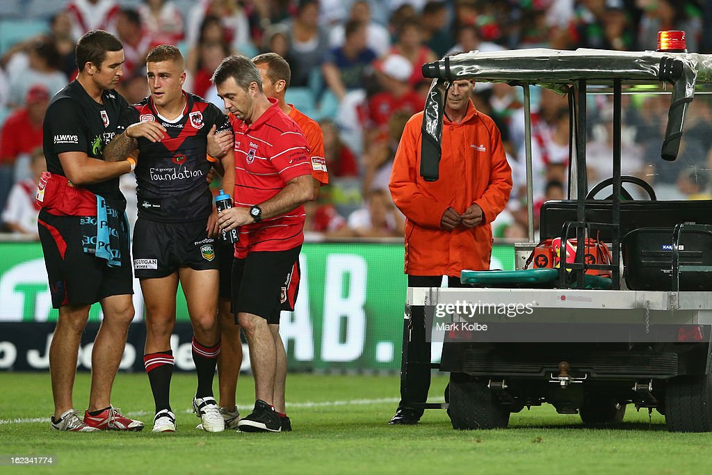 Cameron King of the Dragons is helped to his feet after a heavy head knock during the NRL Charity Shield match between the South Sydney Rabbitohs and the St George Illawarra Dragons at ANZ Stadium on February 22, 2013 in Sydney, Australia.