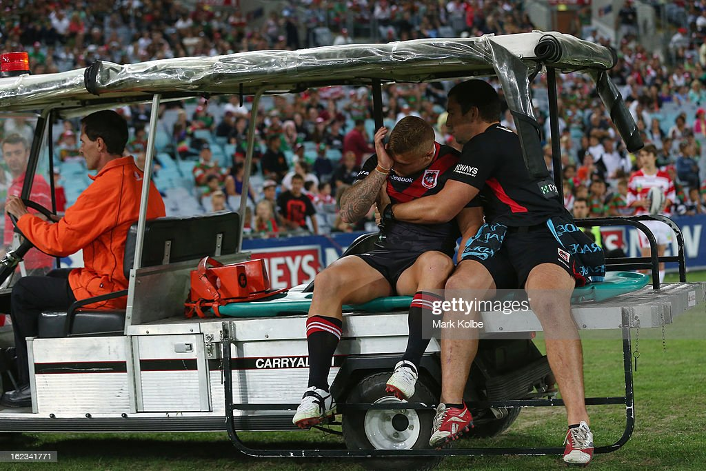 Cameron King of the Dragons is taken from the field after a heavy head knock during the NRL Charity Shield match between the South Sydney Rabbitohs and the St George Illawarra Dragons at ANZ Stadium on February 22, 2013 in Sydney, Australia.