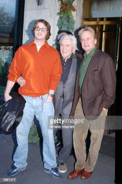 Cameron Kirk and Michael Douglas stand in front of Cipriani's Restaurant December 17 2002 in New York City New York