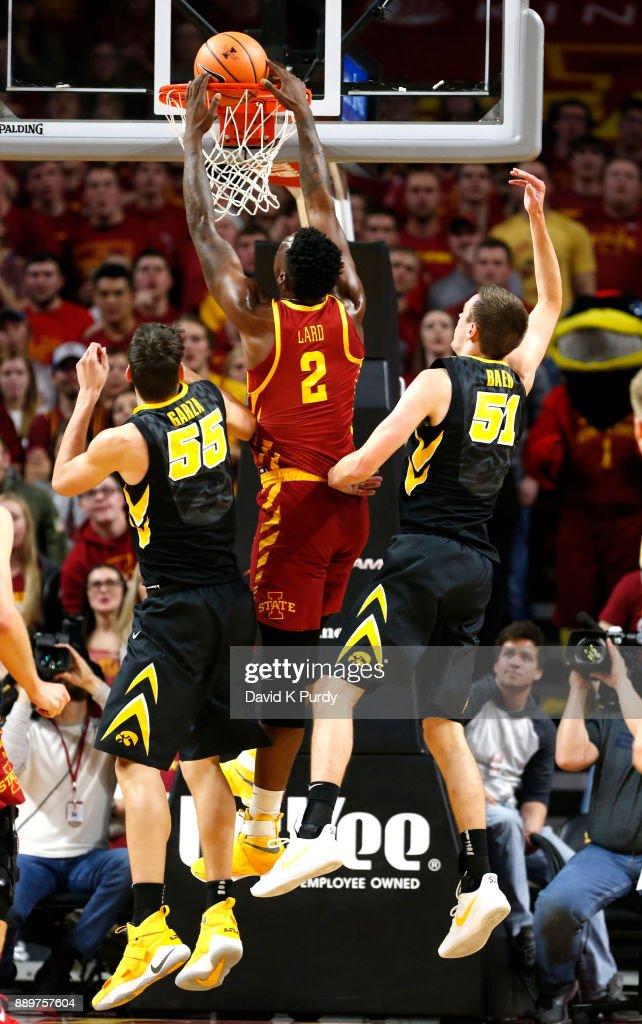 Cameron Lard #2 of the Iowa State Cyclones dunks the ball as Luka Garza #55 of the Iowa Hawkeyes, and Nicholas Baer #51 of the Iowa Hawkeyes defend in the second half of play at Hilton Coliseum on December 7, 2017 in Ames, Iowa. The Iowa State Cyclones won 84-78 over the Iowa Hawkeyes.