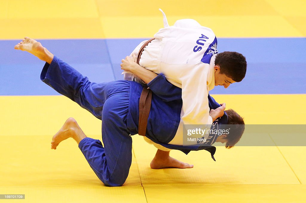 Cameron Leishman (bottom) of Australia competes against Jordan Kouros (top) of Australia in the Men's 66kg Judo during day four of the Australian Youth Olympic Festival at Sydney Olympic Park Sports Halls on January 19, 2013 in Sydney, Australia.