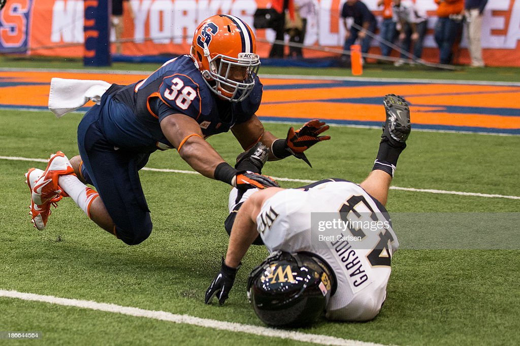 Cameron Lynch #38 of Syracuse Orange pushes down Jordan Garside #43 of Wake Forest Demon Deacons while breaking up a pass in the second quarter on November 2, 2013 at the Carrier Dome in Syracuse, New York. Syracuse shuts out Wake Forest 13-0