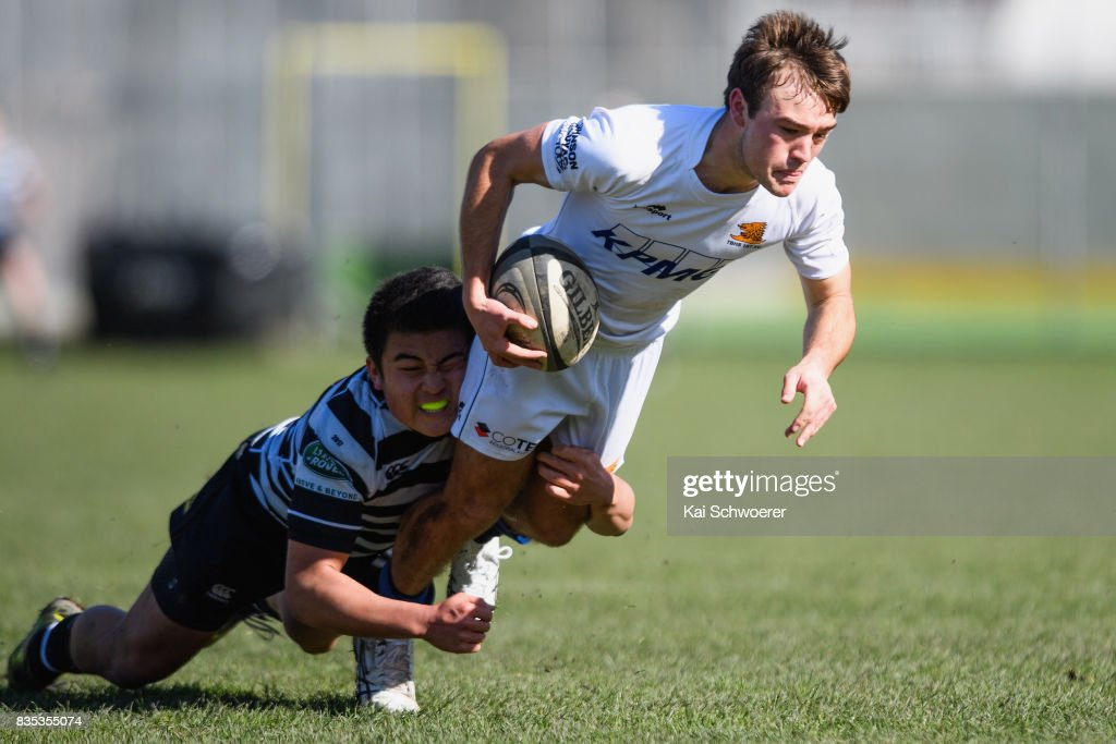 Cameron Lyon of Timaru is tackled by Shun Miyake of Christ's College during the Christchurch High School Semi Final match between Christ's College and Timaru Boys' High School on August 19, 2017 in Christchurch, New Zealand.