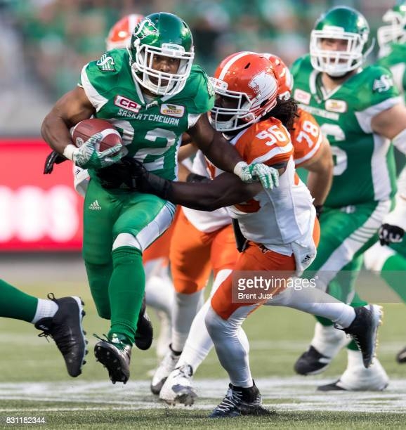 Cameron Marshall of the Saskatchewan Roughriders tries to avoid Solomon Elimimian of the BC Lions during second half action in the game between the...