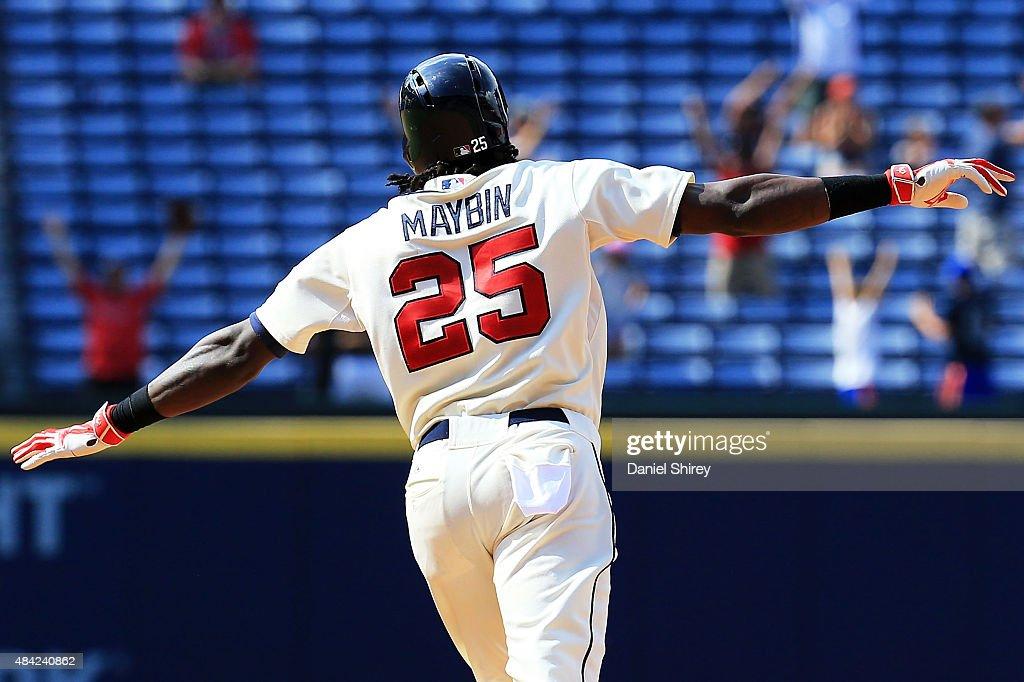 Cameron Maybin of the Atlanta Braves celebrates a walk off home run in the tenth inning against the Arizona Diamondbacks at Turner Field on August 16...