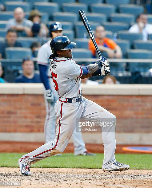 Cameron Maybin of the Atlanta Braves follows through on an eleventh inning two run base hit against the New York Mets at Citi Field on June 13 2015...