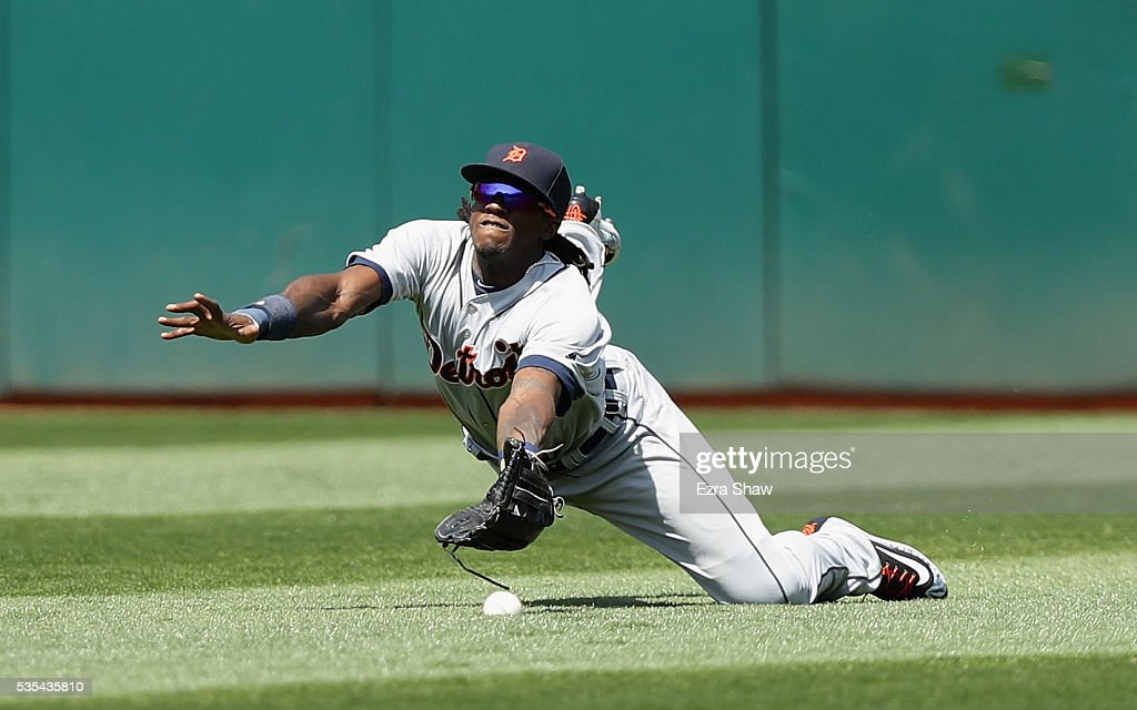 Cameron Maybin #4 of the Detroit Tigers can not catch a ball hit by Billy Butler #16 of the Oakland Athletics in the sixth inning at the Coliseum on May 29, 2016 in Oakland, California. The hit scored two runs.