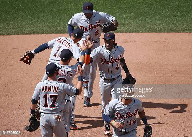 Cameron Maybin of the Detroit Tigers celebrates their victory with Ian Kinsler and teammates during MLB game action against the Toronto Blue Jays on...