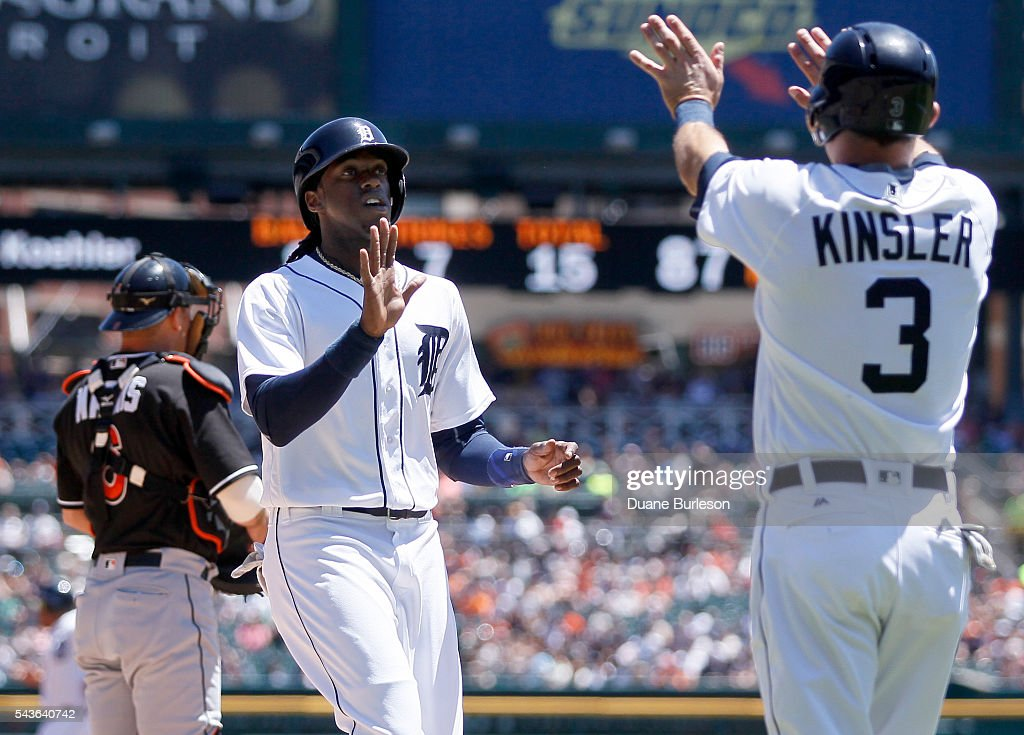 <a gi-track='captionPersonalityLinkClicked' href=/galleries/search?phrase=Cameron+Maybin&family=editorial&specificpeople=2364846 ng-click='$event.stopPropagation()'>Cameron Maybin</a> #4 of the Detroit Tigers celebrates with <a gi-track='captionPersonalityLinkClicked' href=/galleries/search?phrase=Ian+Kinsler&family=editorial&specificpeople=538104 ng-click='$event.stopPropagation()'>Ian Kinsler</a> #3 of the Detroit Tigers after scoring past catcher <a gi-track='captionPersonalityLinkClicked' href=/galleries/search?phrase=Jeff+Mathis&family=editorial&specificpeople=660661 ng-click='$event.stopPropagation()'>Jeff Mathis</a> #6 of the Miami Marlins on a single by Victor Martinez of the Detroit Tigers during the first inning at Comerica Park on June 29, 2016 in Detroit, Michigan.