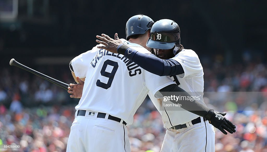 <a gi-track='captionPersonalityLinkClicked' href=/galleries/search?phrase=Cameron+Maybin&family=editorial&specificpeople=2364846 ng-click='$event.stopPropagation()'>Cameron Maybin</a> #4 of the Detroit Tigers celebrates with teammate <a gi-track='captionPersonalityLinkClicked' href=/galleries/search?phrase=Nick+Castellanos&family=editorial&specificpeople=6129175 ng-click='$event.stopPropagation()'>Nick Castellanos</a> #9 after scoring during the fifth inning of the inter-league game against the Philadelphia Phillies on May 25, 2016 at Comerica Park in Detroit, Michigan.
