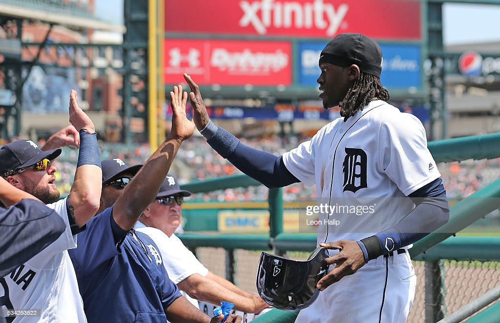 <a gi-track='captionPersonalityLinkClicked' href=/galleries/search?phrase=Cameron+Maybin&family=editorial&specificpeople=2364846 ng-click='$event.stopPropagation()'>Cameron Maybin</a> #4 of the Detroit Tigers celebrates with teammates after scoring during the fifth inning of the inter-league game against the Philadelphia Phillies on May 25, 2016 at Comerica Park in Detroit, Michigan.