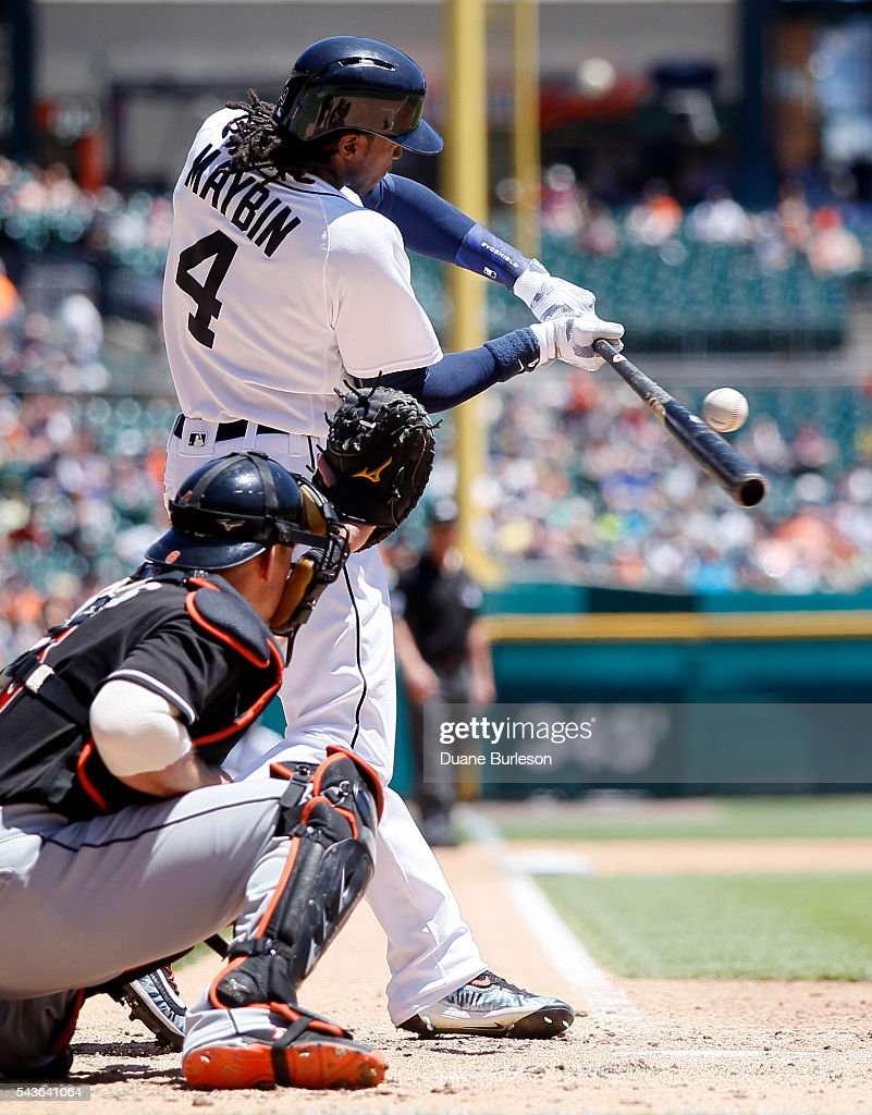 <a gi-track='captionPersonalityLinkClicked' href=/galleries/search?phrase=Cameron+Maybin&family=editorial&specificpeople=2364846 ng-click='$event.stopPropagation()'>Cameron Maybin</a> #4 of the Detroit Tigers fouls out down the first base line to advance Ian Kinsler of the Detroit Tigers to third base as catcher Adeiny Hechavarria #3 of the Miami Marlins works behind the plate during the second inning at Comerica Park on June 29, 2016 in Detroit, Michigan.